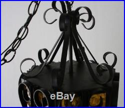 Mid Century Mexican Wrought Iron And Textured Amber Glass Hanging Swag Lamp