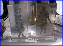 Pair of Mid Century Modern Glass block Silhouette sculptures Copper Lucite
